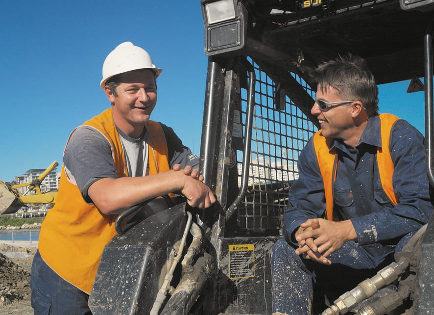 Image of young worker and supervisor on construction site